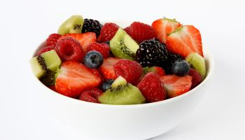 Bowl of fresh soft fruits and berries.