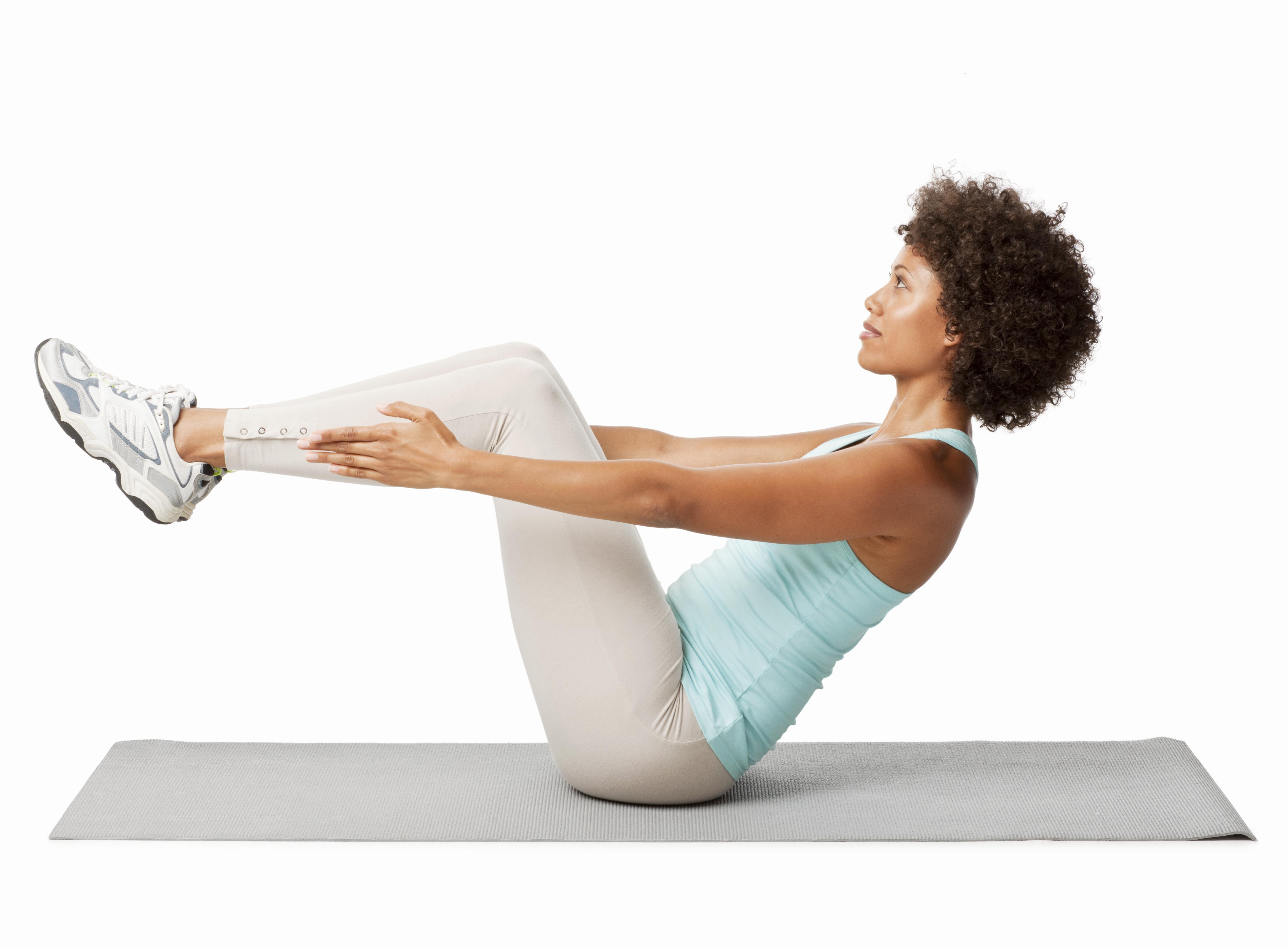 Side view of a woman exercising with leg lift crunches on the floor. Horizontal shot. Isolated on white.