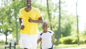 Father and son jogging together.