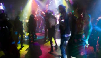 People dancing in night club