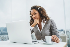 Pensive African American businesswoman using computer at office.
