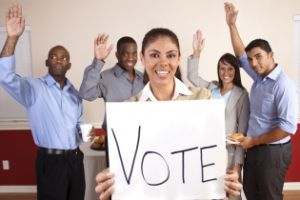 Mixed Ethnic Group of Young Adults with Vote Sign