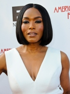 24 Flawless Photos That Prove Angela Bassett Drinks Virgin Blood & Bathes In Baby Tears