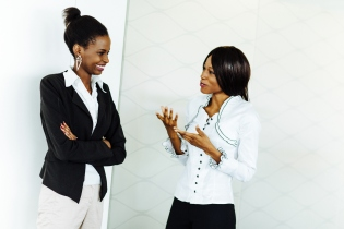 Female co-workers discussing