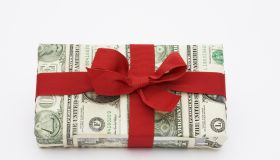 A gift wrapped in dollar bills