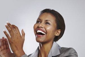 Happy businesswoman clapping hands