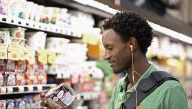 Man Reading Nutrition Label