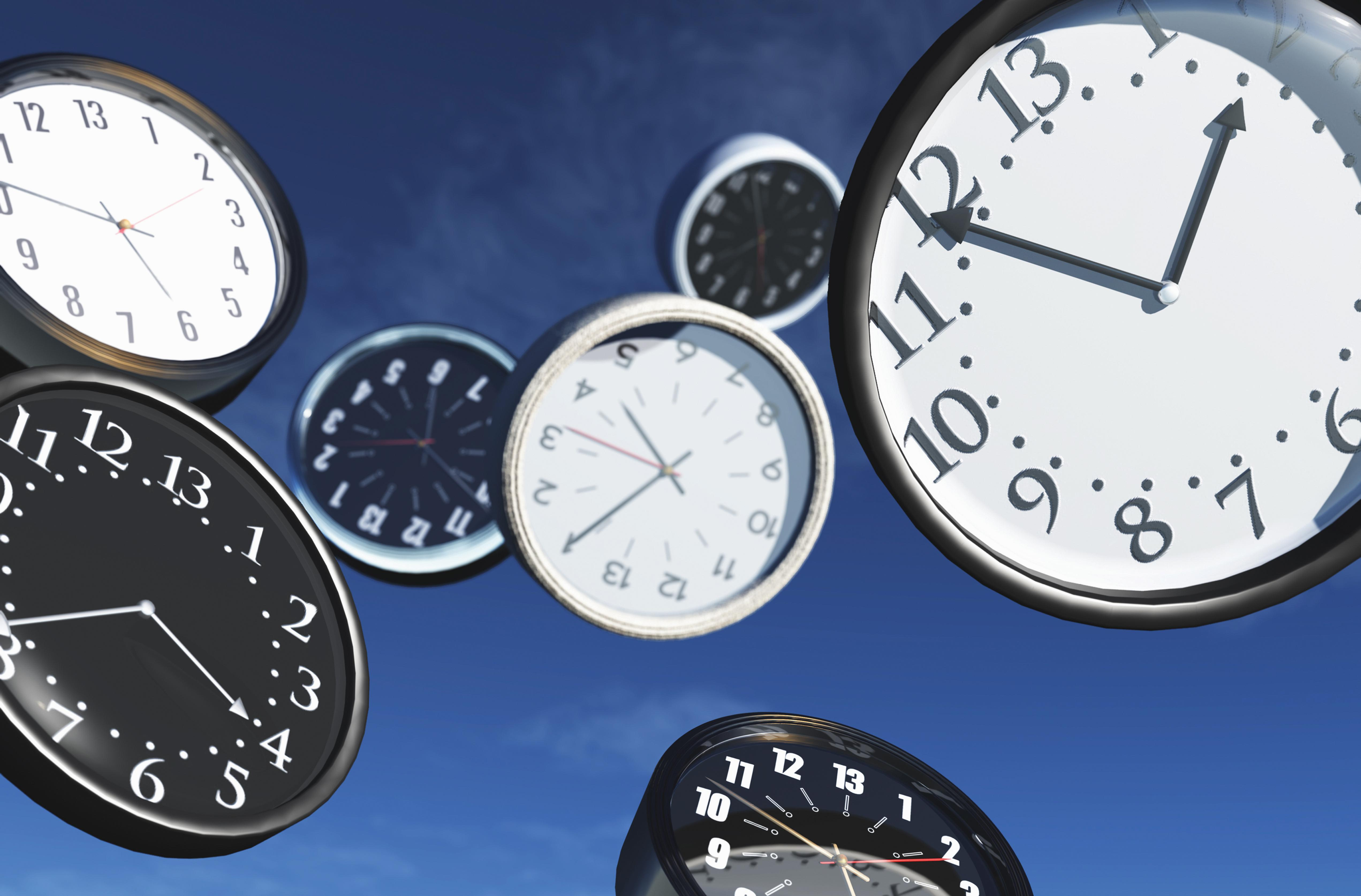 Variety of flying clocks with different time