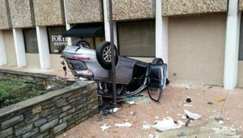 Car falls 4 stories