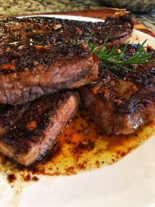 Herbed Strip Steak with Hennessy Garlic Butter