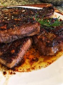 Herbed Strip Steak with Hennessy Garlic Butter
