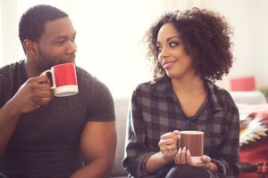 Afro american couple drinking coffee at home