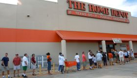 Residents of Houston, Tex., line up outside a Home Depot, on