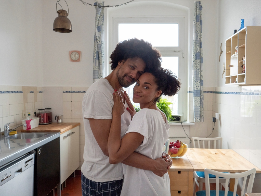 Morning love, couple in kitchen, looking at camera