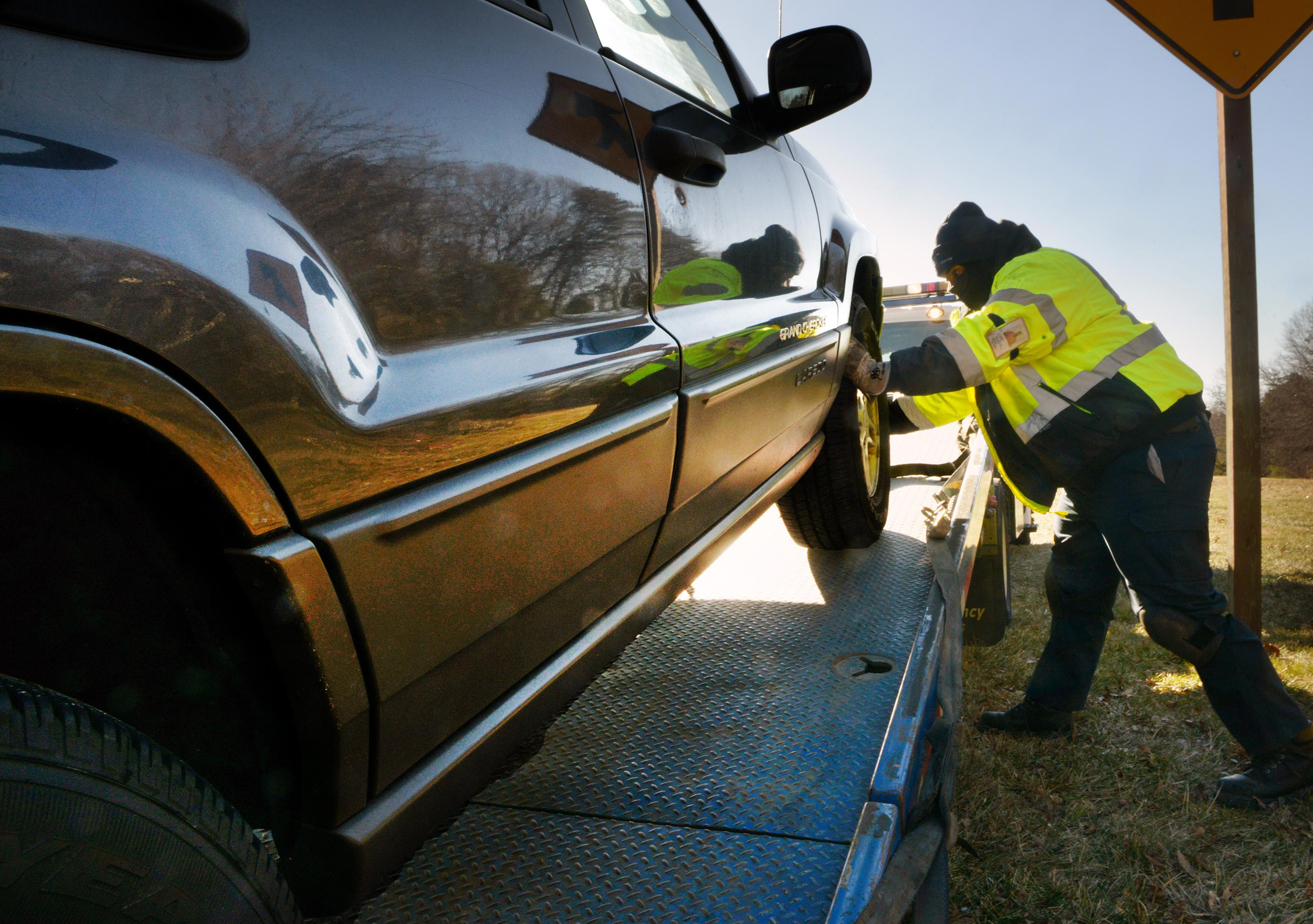 Riding with AAA as extremely cold temperatures lead to many auto problems, in Landover, MD.