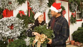 Couple choosing Christmas wreath