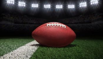 Close-Up Of American Football On Field At Night