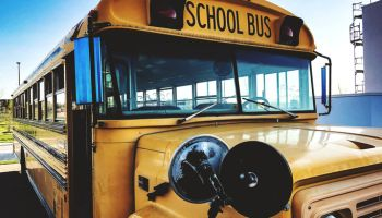 Close-Up Of School Bus On Footpath