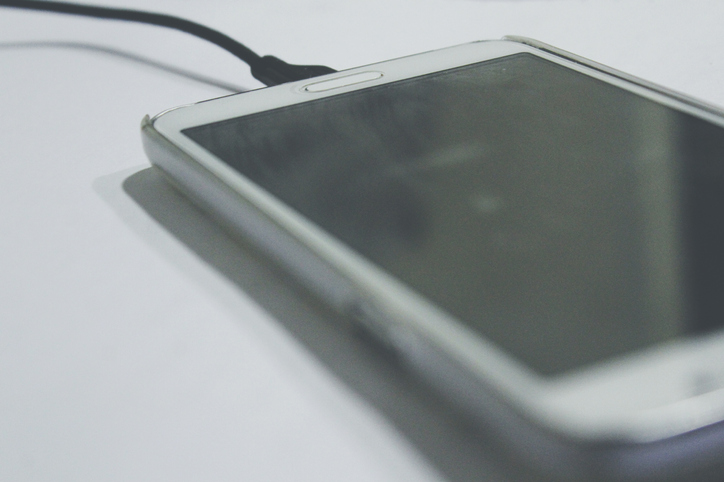 Close-Up Of Mobile Phone On Table