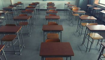 Empty Chairs In Classroom At School