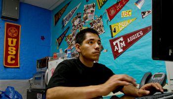 Edgar Flores-Villalobos (CQ), 18, fills out a form for a scholarship as seniors at Garfield High Sc