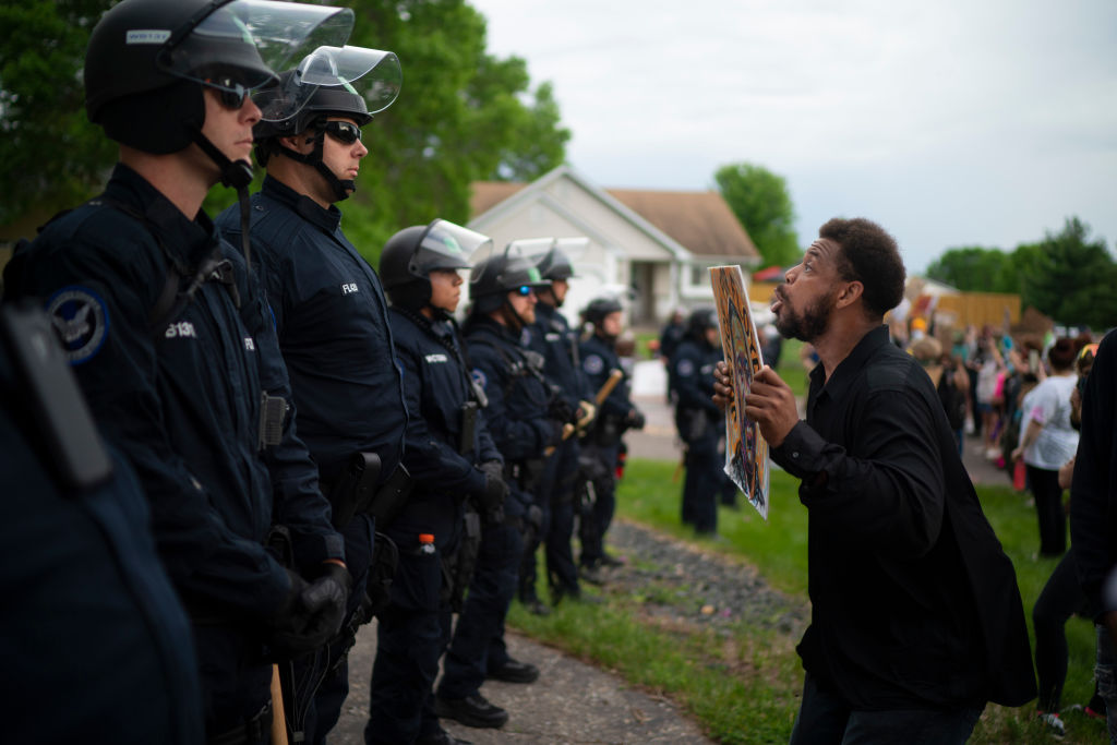 Minnesota community members mourned, protested and looted in reaction to George Floyd dying in police custody